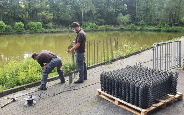 Construction d'une clôture autour d'un lac